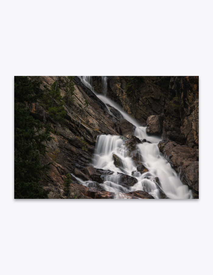 The Grand Teton's glacial and seasonal snow melt winds it's way down through Cascade Canyon's rocky gorge and over the Hidden Falls, before making it's way into Jenny Lake.