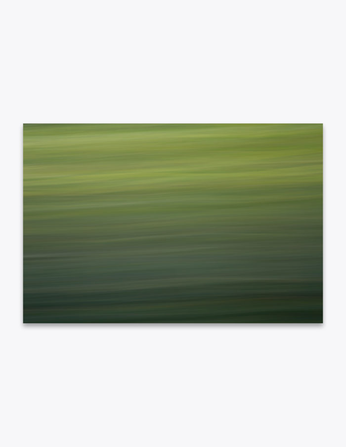 During springtime, when driving through the Flint Hills and Tallgrass Prairie National Preserve in Kansas, the vast fields glow in a lustrous green from the sunlight peeking through the clouds. To capture the essence of the scene, I did some experimenting with dragging my camera's shutter just enough to create this abstract from the blades of grass.