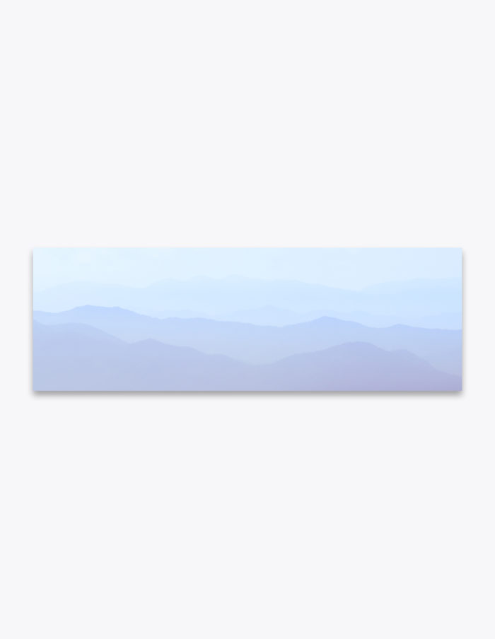 The soft and subtle foothills of the Smoky Mountains glazed over with a hint of fog offers depth and atmospheric perspetive.