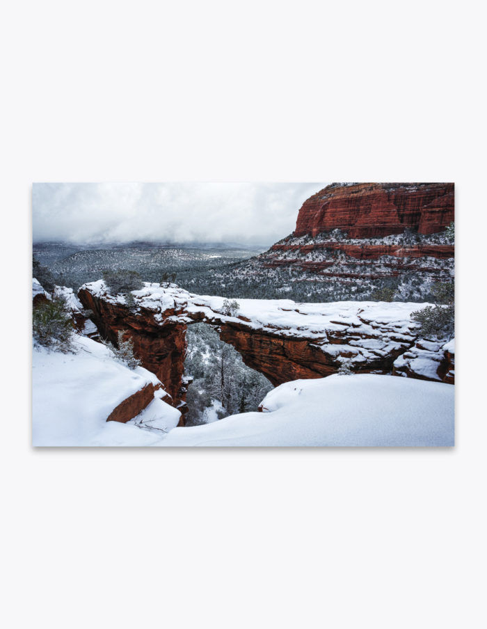 Bridge ices before trail. One year ago today, we hiked to the top of Devil's Bridge overlook just after a rare snowstorm in Sedona, Arizona. The red sandstone cliffs offered a beautifully stark contrast to the fresh white snow over the desert landscape.