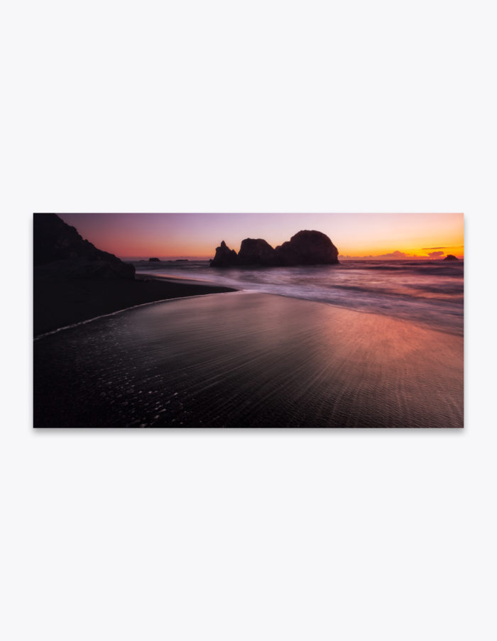 The sun-warmed black sand beaches of Northern California quickly cool in the oncoming tide of the Pacific Ocean. It's quite refreshing combined with the ocean breeze, particularly after a day of hiking through the humid Redwoods trees.