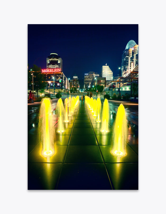 Children play in the color changing fountains along the Cincinnati Riverfront
